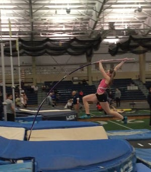 Erica Ellis on her way up and over the bar during her jump of 14 feet-1 1/4 inch during January 2018.