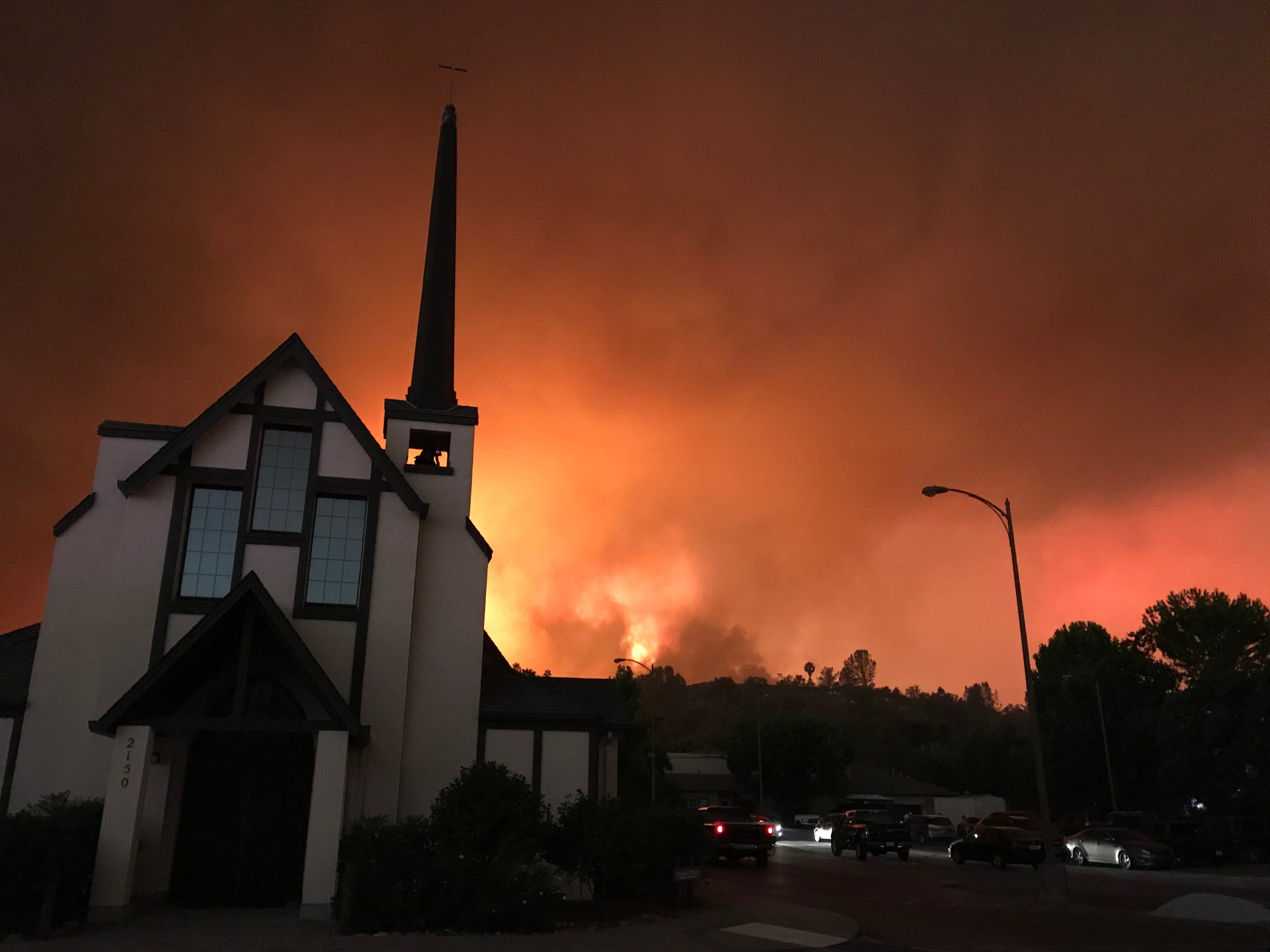 Flames from the Carr Fire threaten the All Saints' Episcopal Church on Benton Drive in Redding.