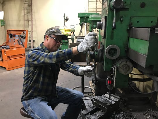 Welder and millwright Frank Vazquez demonstrates how use of a drill press. He's worked at Sierra Pacific Industries for 11 years.
