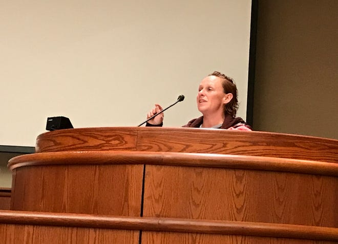 Stephanie Anderson speaks before the Redding City Council on Tuesday night during a public hearing on an anti-camping ordinance. Anderson said she's homeless and is camping in Redding. She said many homeless people don't have the know-how to find the right resources to better themselves.