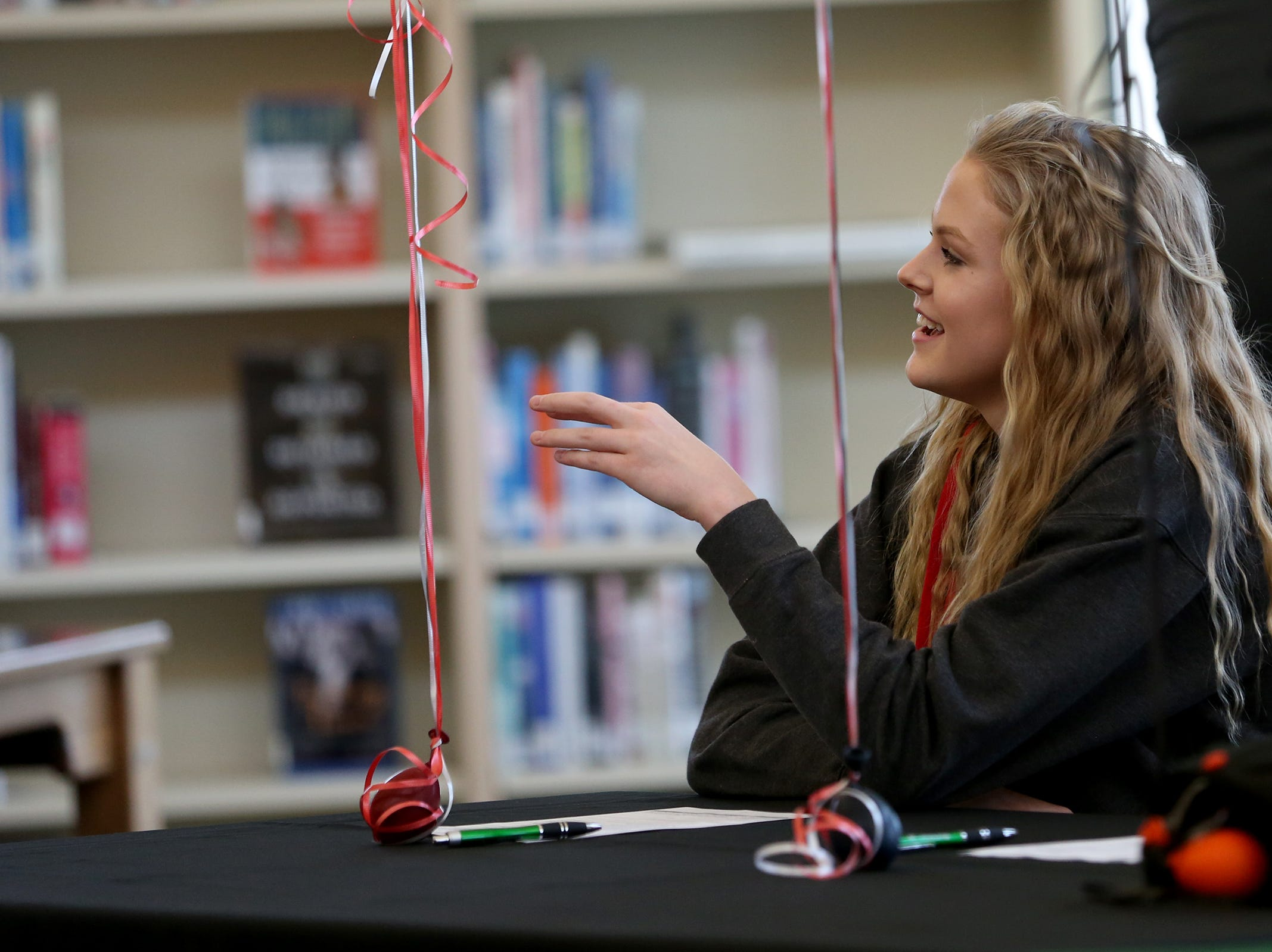 West Salem High School senior, Kimmie Bain thanks her family and friends in the school library on Wednesday, Dec. 19, 2018. Bain signed to Western Oregon University to play volleyball.