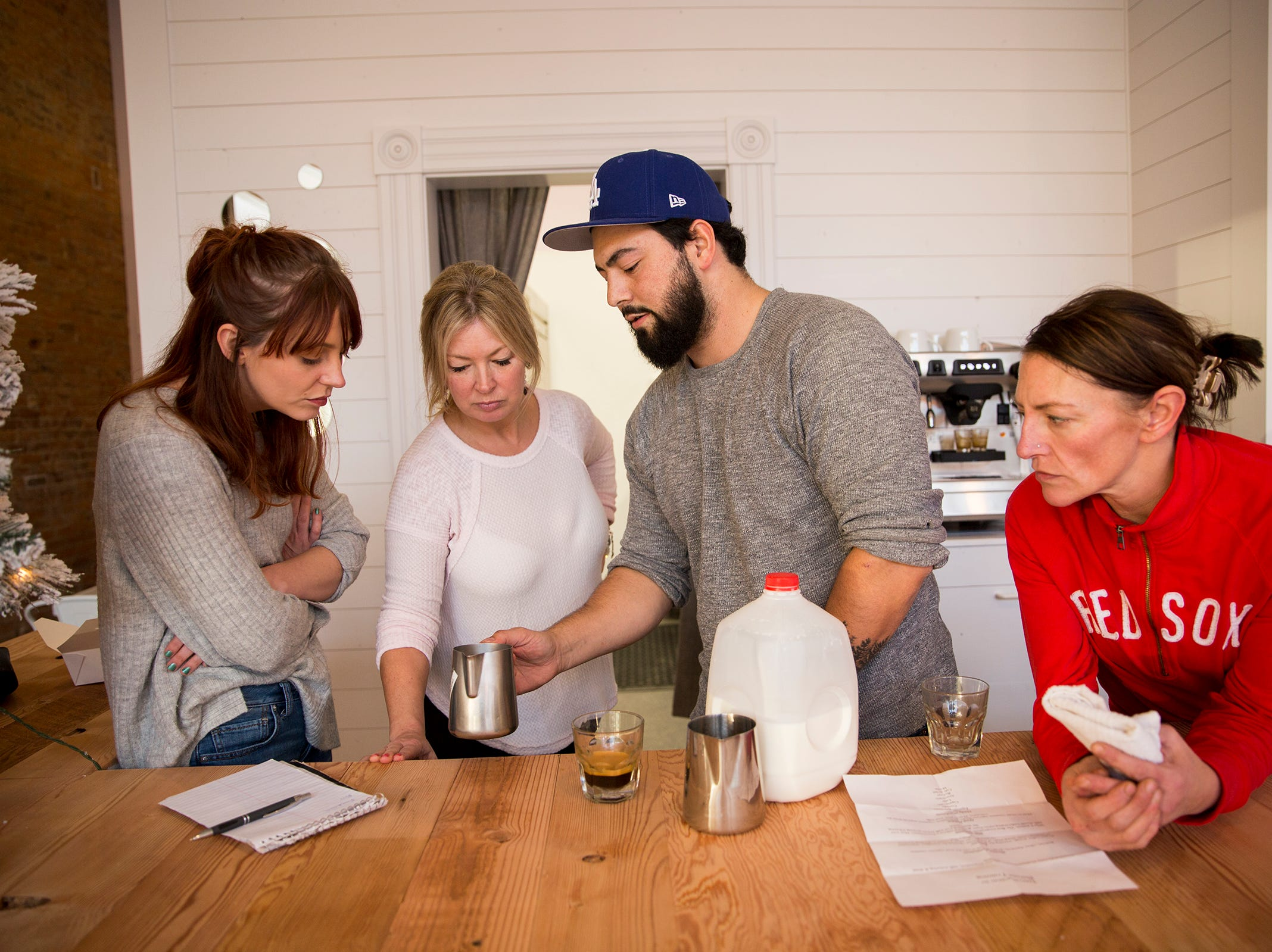 Server Mara Bivins, owner Dana Heuberger and chef Megan Brady learn how to make espresso-based drinks from barista trainer Brandon Sanders at Jubilee Champagne & Dessert Bar in Independence on Tuesday, Dec. 19, 2018.