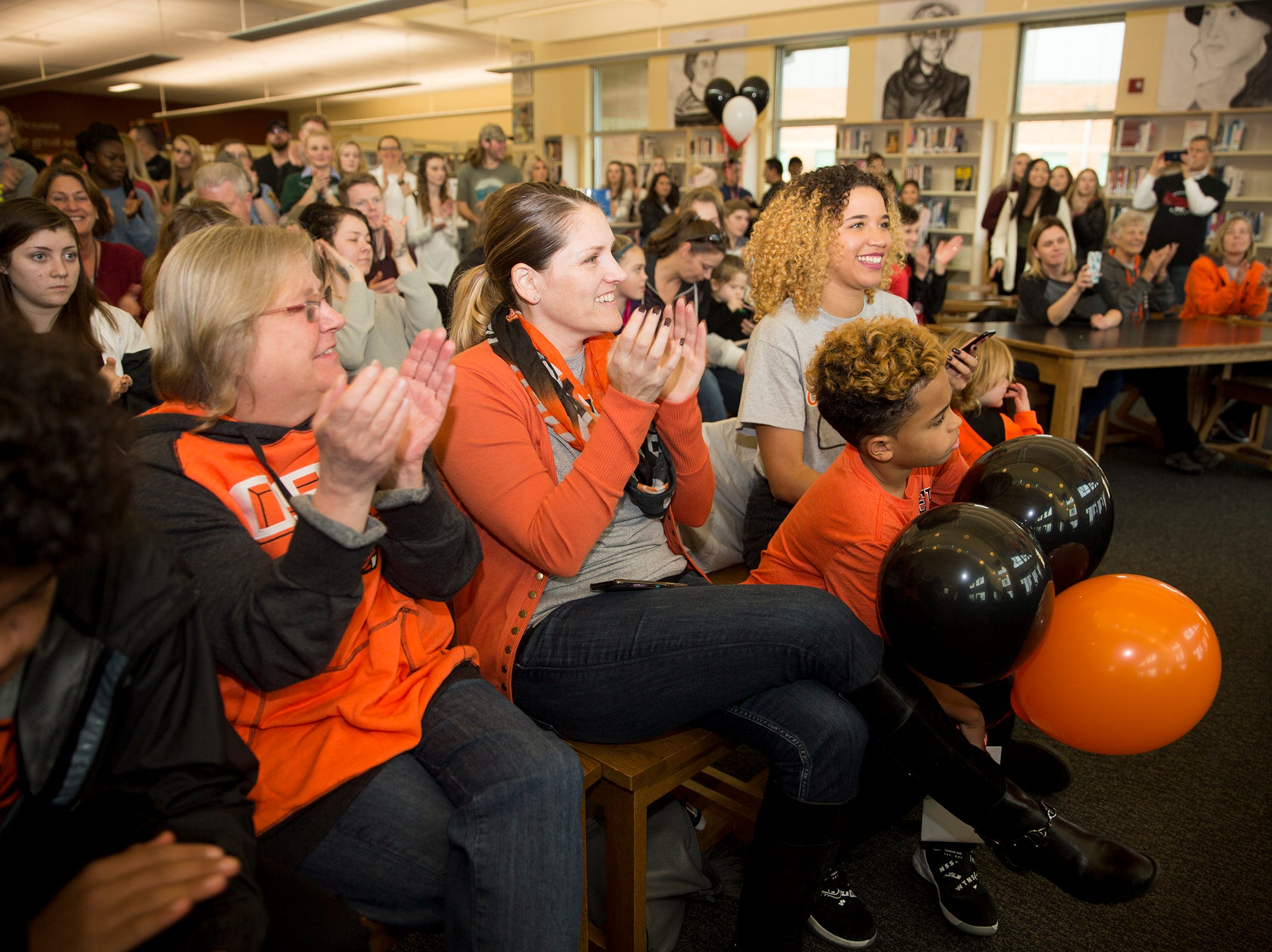 West Salem High School's Anthony Gould's family supports him in Oregon State attire as he signs on Wednesday, Dec. 19, 2018