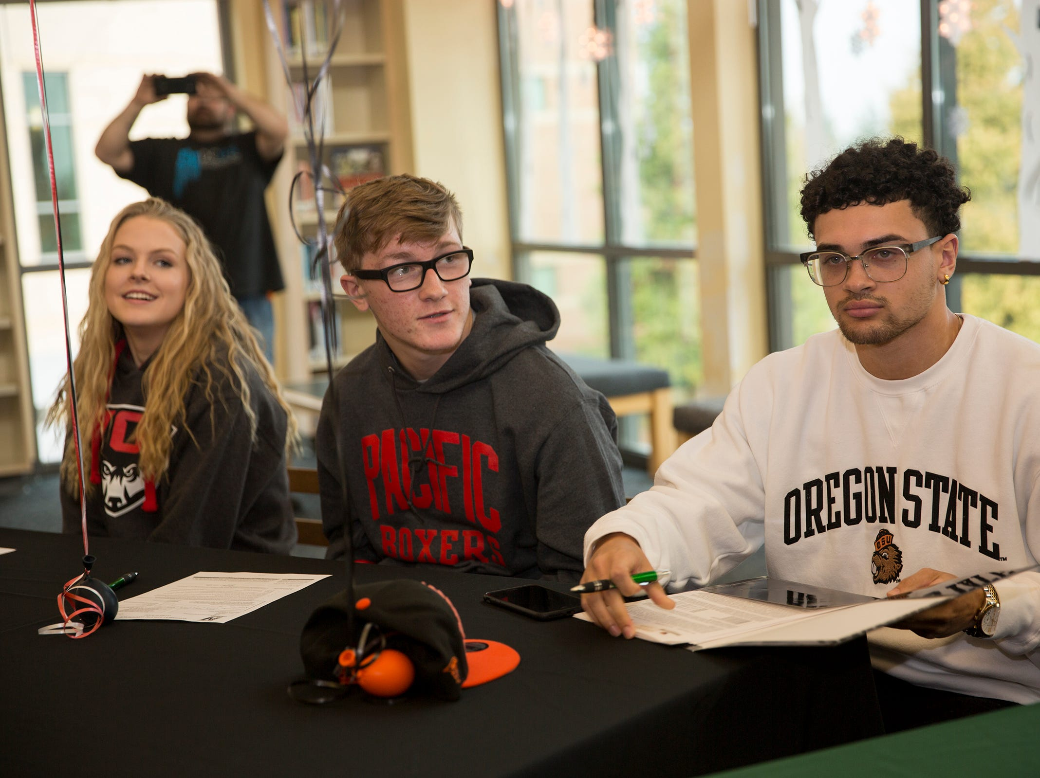 West Salem High School's Anthony Gould (far right) before signing to Oregon State in the school library on Wednesday, Dec. 19, 2018