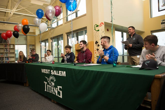 West Salem High School senior athletes sign to their respective colleges in the school library on Wednesday, Dec. 19, 2018.