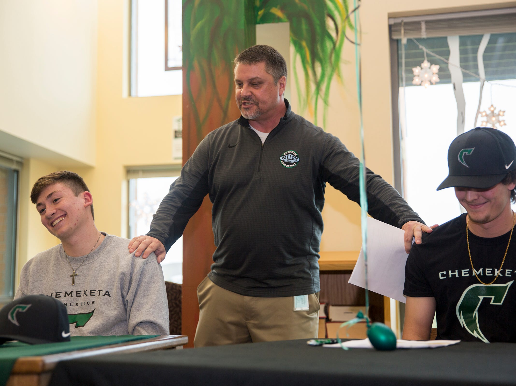 Bill Wittman, the West Salem athletic director, reaches out to seniors Noah Juarez and Branden Allison on Wednesday, Dec. 19, 2018. The two athletes will play baseball together at Chemeketa.