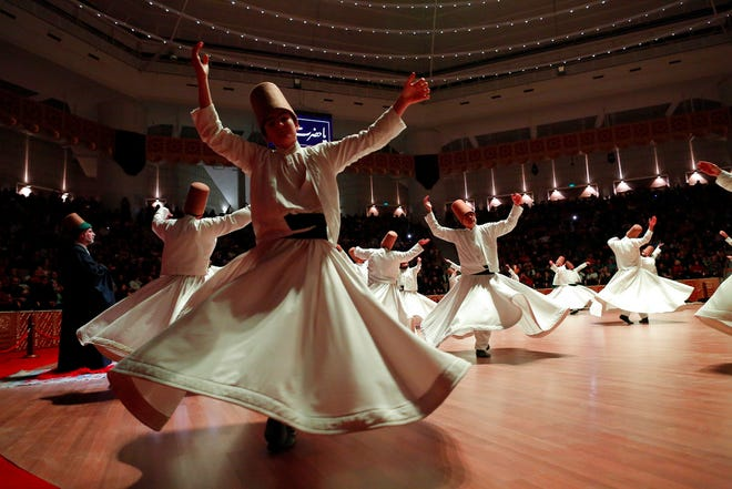 In this photo taken on Sunday, Dec. 16, 2018, whirling dervishes of the Mevlevi order perform during a Sheb-i Arus ceremony in Konya, central Turkey. Every December the Anatolian city hosts a series of events to commemorate the death of 13th century Islamic scholar, poet and Sufi mystic Jalaladdin Rumi.