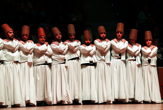 In this photo taken on Sunday, Dec. 16, 2018, whirling dervishes of the Mevlevi order prepare for the Sheb-i Arus ceremony in Konya, central Turkey. Every December the Anatolian city hosts a series of events to commemorate the death of 13th century Islamic scholar, poet and Sufi mystic Jalaladdin Rumi.