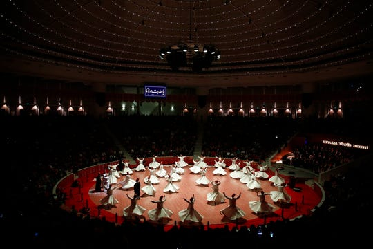 In this photo taken on Sunday, Dec. 16, 2018, whirling dervishes of the Mevlevi order perform at the start of a Sheb-i Arus ceremony in Konya, central Turkey. Every December the Anatolian city hosts a series of events to commemorate the death of 13th century Islamic scholar, poet and Sufi mystic Jalaladdin Rumi.
