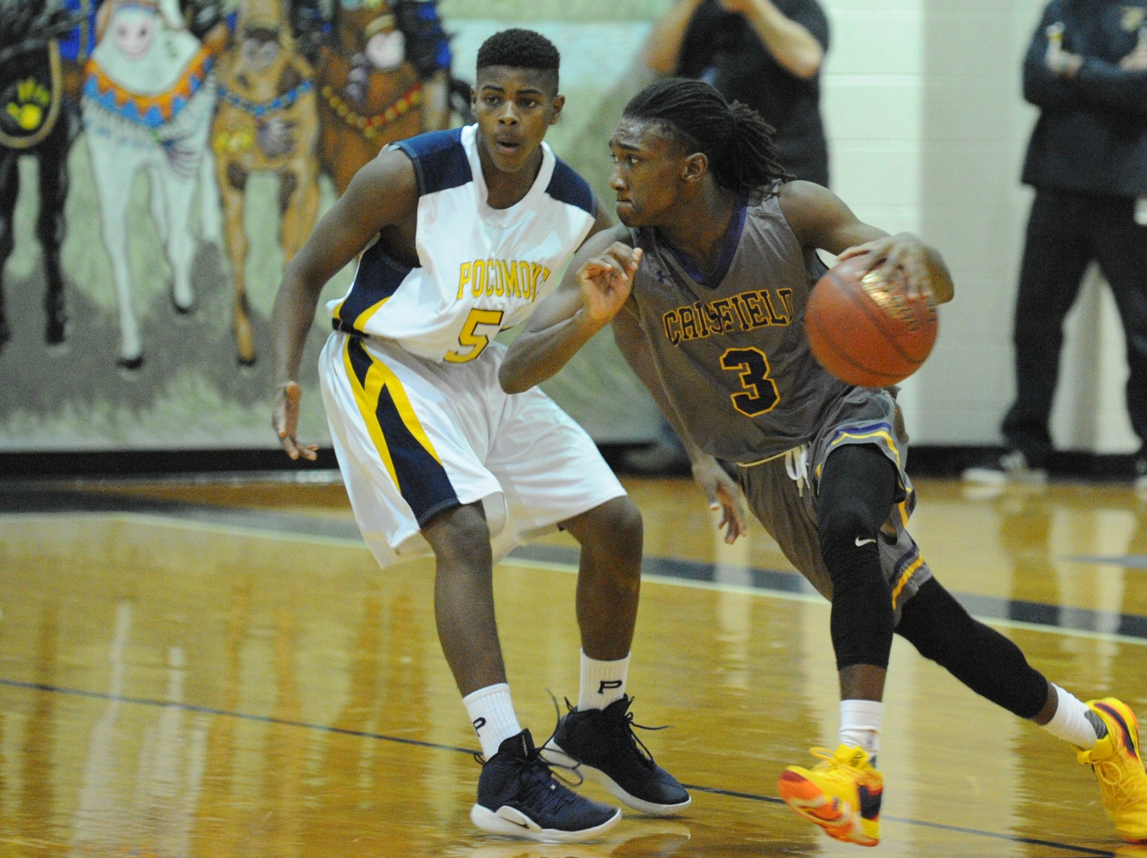 Crisfield's Rykell Waters takes the ball past Pocomoke's Nick Evans on Tuesday, Dec. 18, 2018. Crisfield won the game, 90-35.