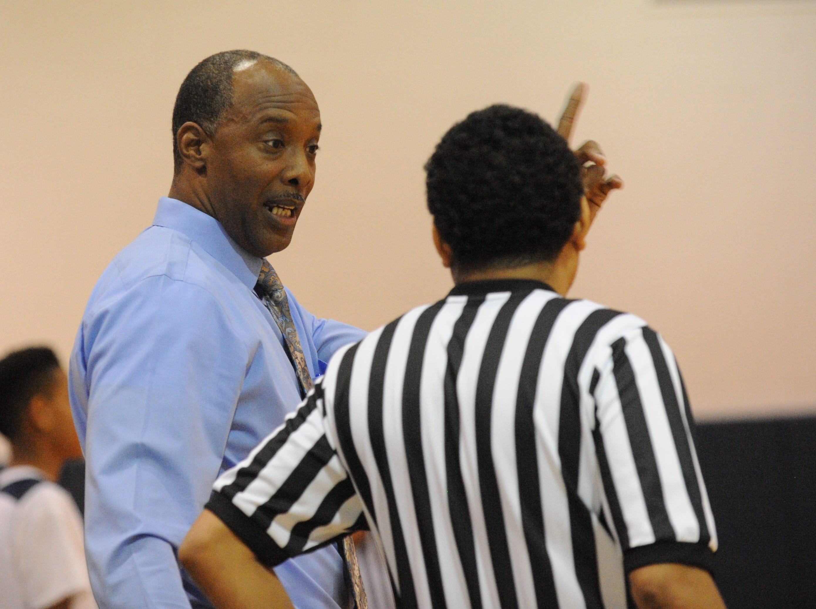 Pocomoke coach Derrick Fooks talks with an official on Tuesday, Dec. 18, 2018. Crisfield beat Pocomoke, 90-35.