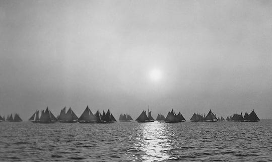 A vintage photo of the oyster fleet in the Chesapeake Bay, probably taken around the early 20th century.