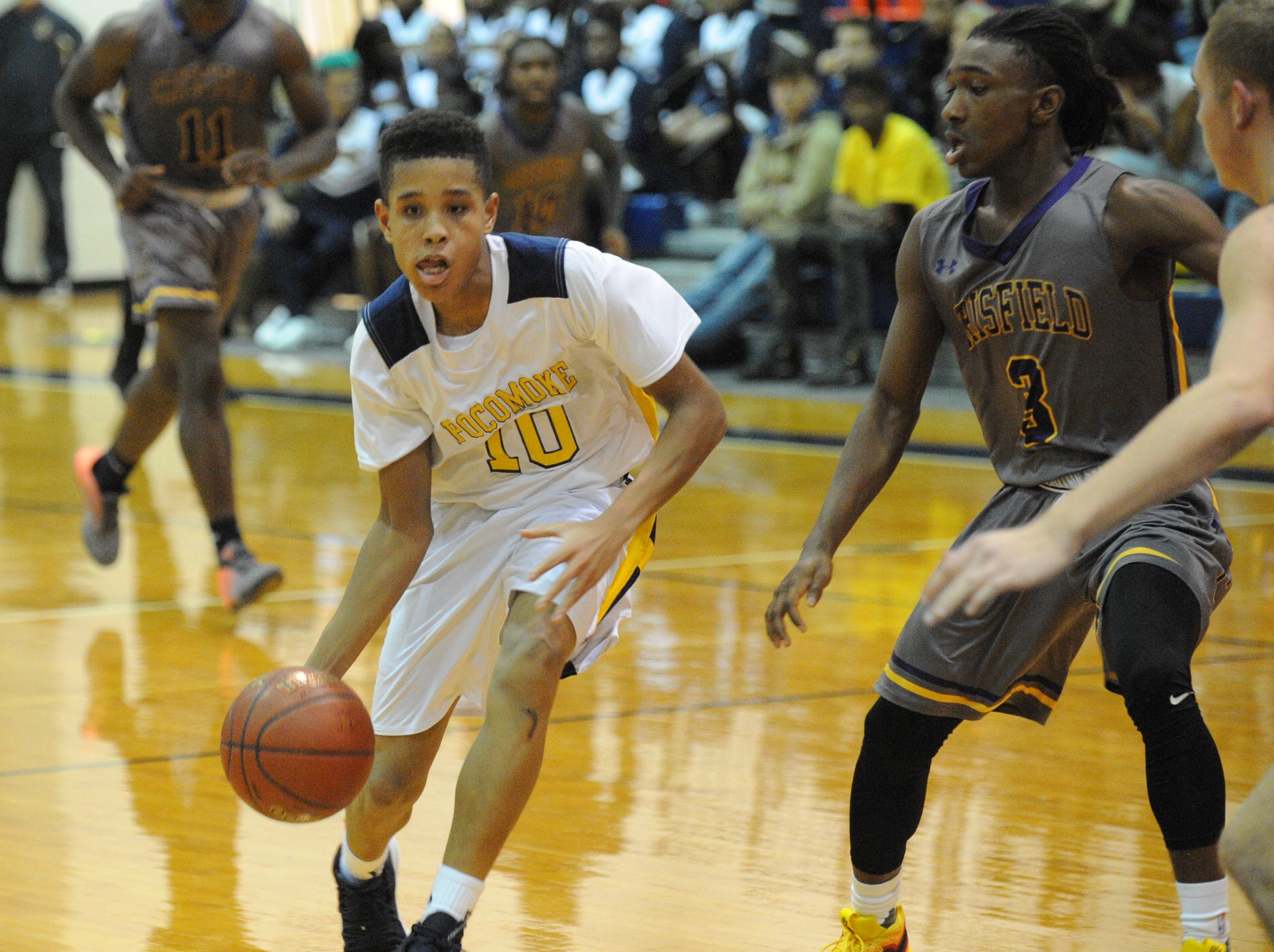 Pocomoke's Charles Finney III dribbles the ball against Crisfield on Tuesday, Dec. 18, 2018. Crisfield won the game, 90-35.