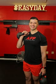 Anthony Flores, owner of Anthony Flores Fitness, posses at his business, Wednesday, December 19, 2108, in Sheboygan, Wis.