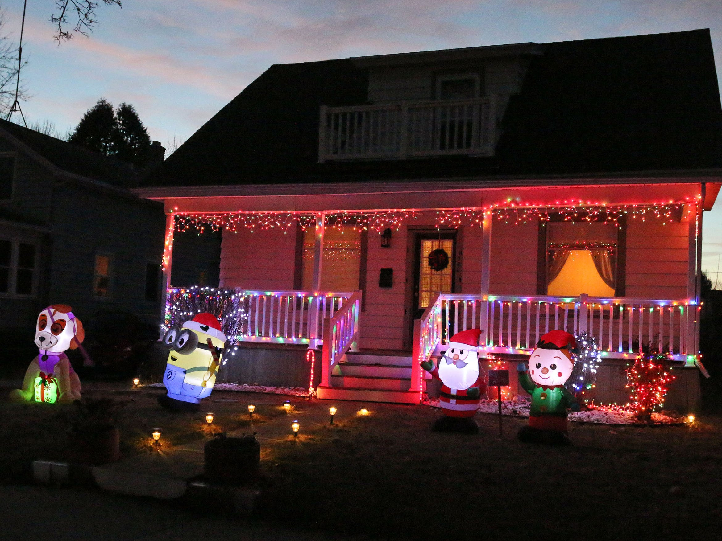 A minion stands guard on this North 3rd Street holiday display, Tuesday, December 18, 2108, in Sheboygan, Wis.