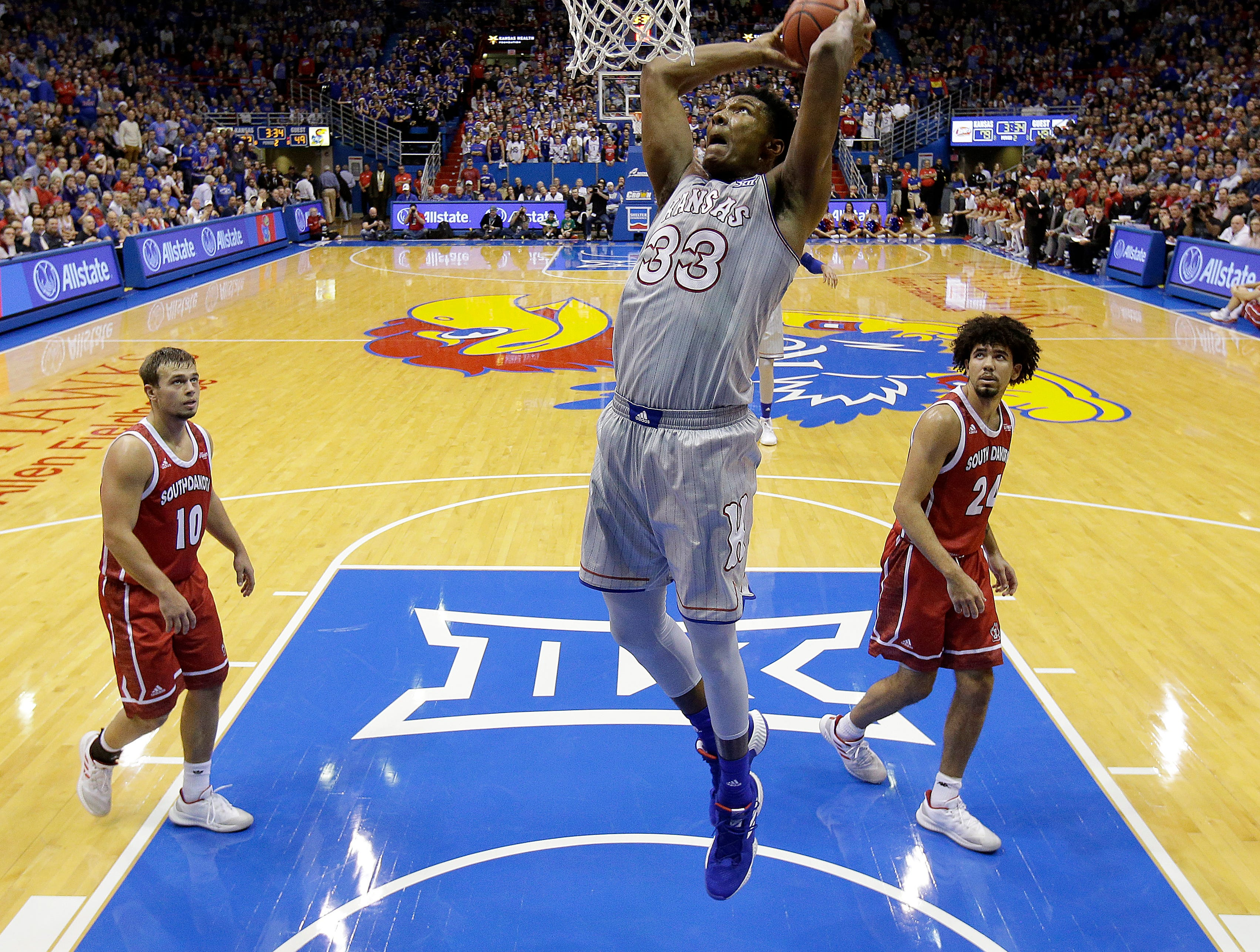 Kansas' David McCormack (33) dunks the ball during the second half of an NCAA college basketball game against South Dakota Tuesday, Dec. 18, 2018, in Lawrence, Kan. Kansas won 89-53. (AP Photo/Charlie Riedel)