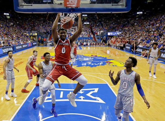 South Dakota's Stanley Umude (0) dunks the ball during the first half of an NCAA college basketball game against Kansas Tuesday, Dec. 18, 2018, in Lawrence, Kan. (AP Photo/Charlie Riedel)
