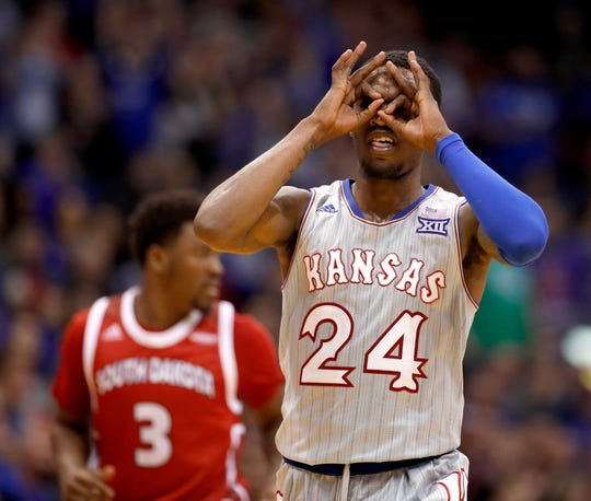 Kansas' Lagerald Vick (24) celebrates after making a basket during the second half of an NCAA college basketball game against South Dakota Tuesday, Dec. 18, 2018, in Lawrence, Kan. Kansas won 89-53. (AP Photo/Charlie Riedel)