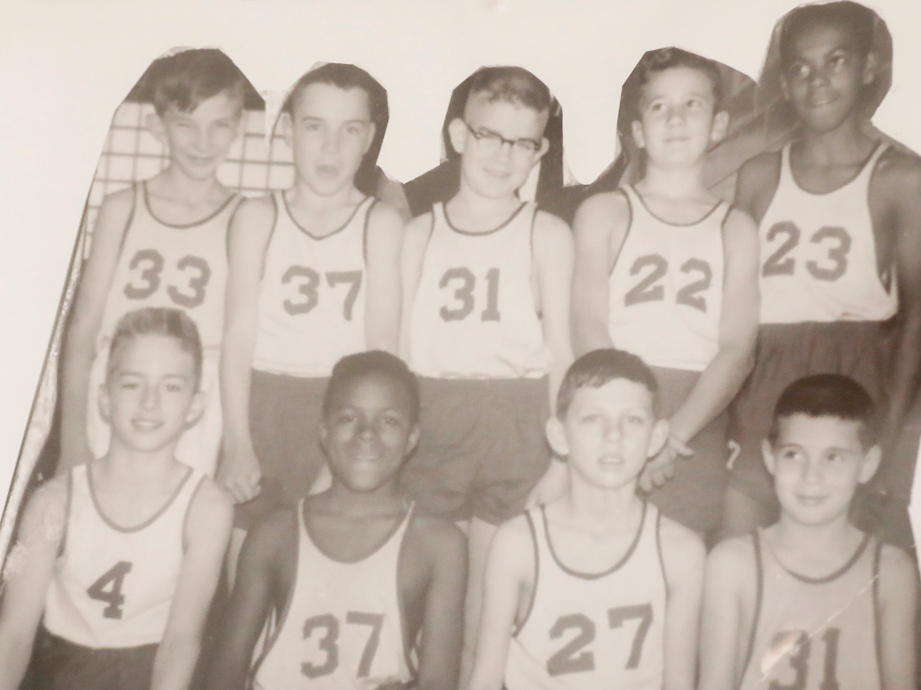 Denny Whayne, top right, with his undefeated basketball team in 1957.