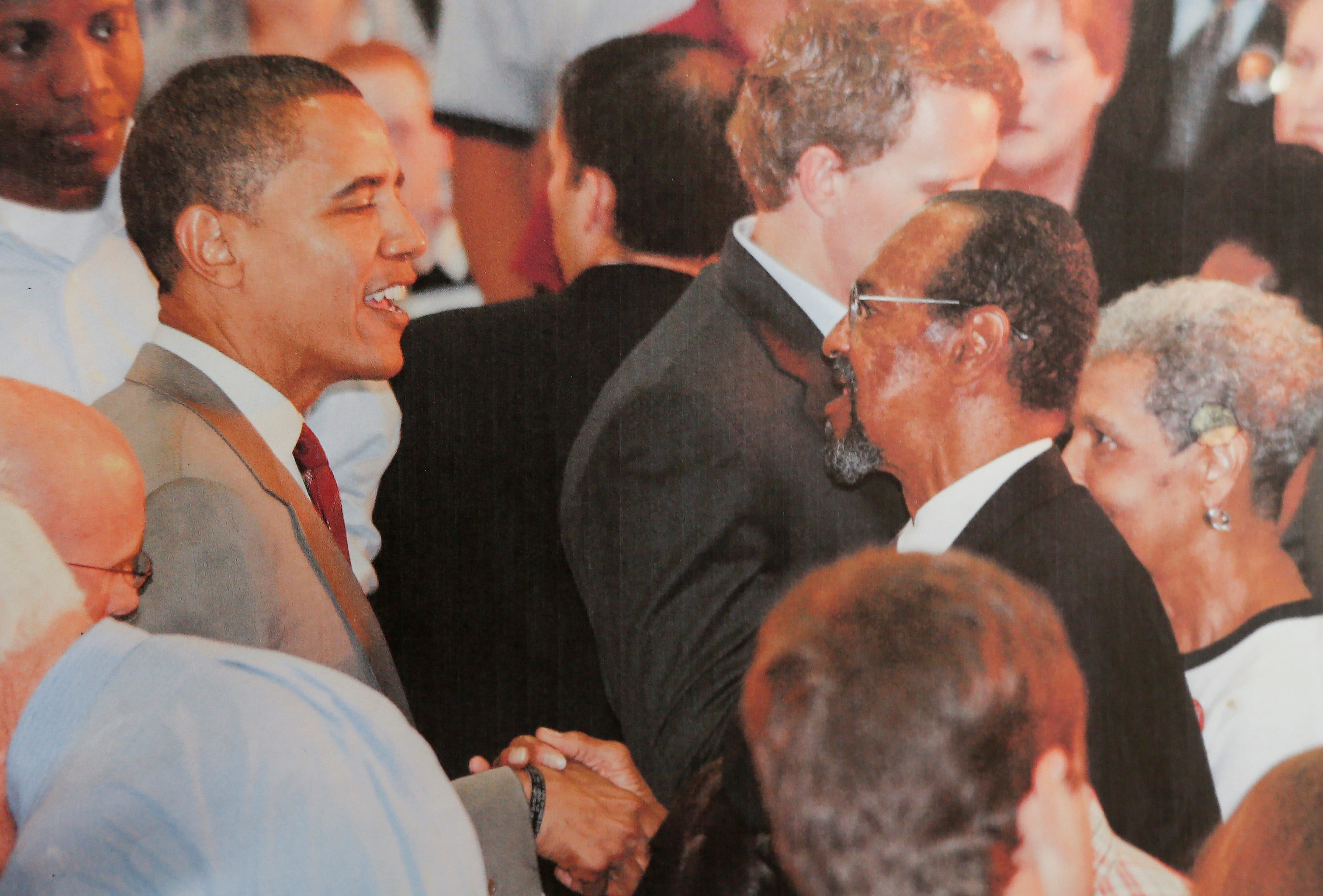 Denny Whayne, right, shakes hands with President Barack Obama.