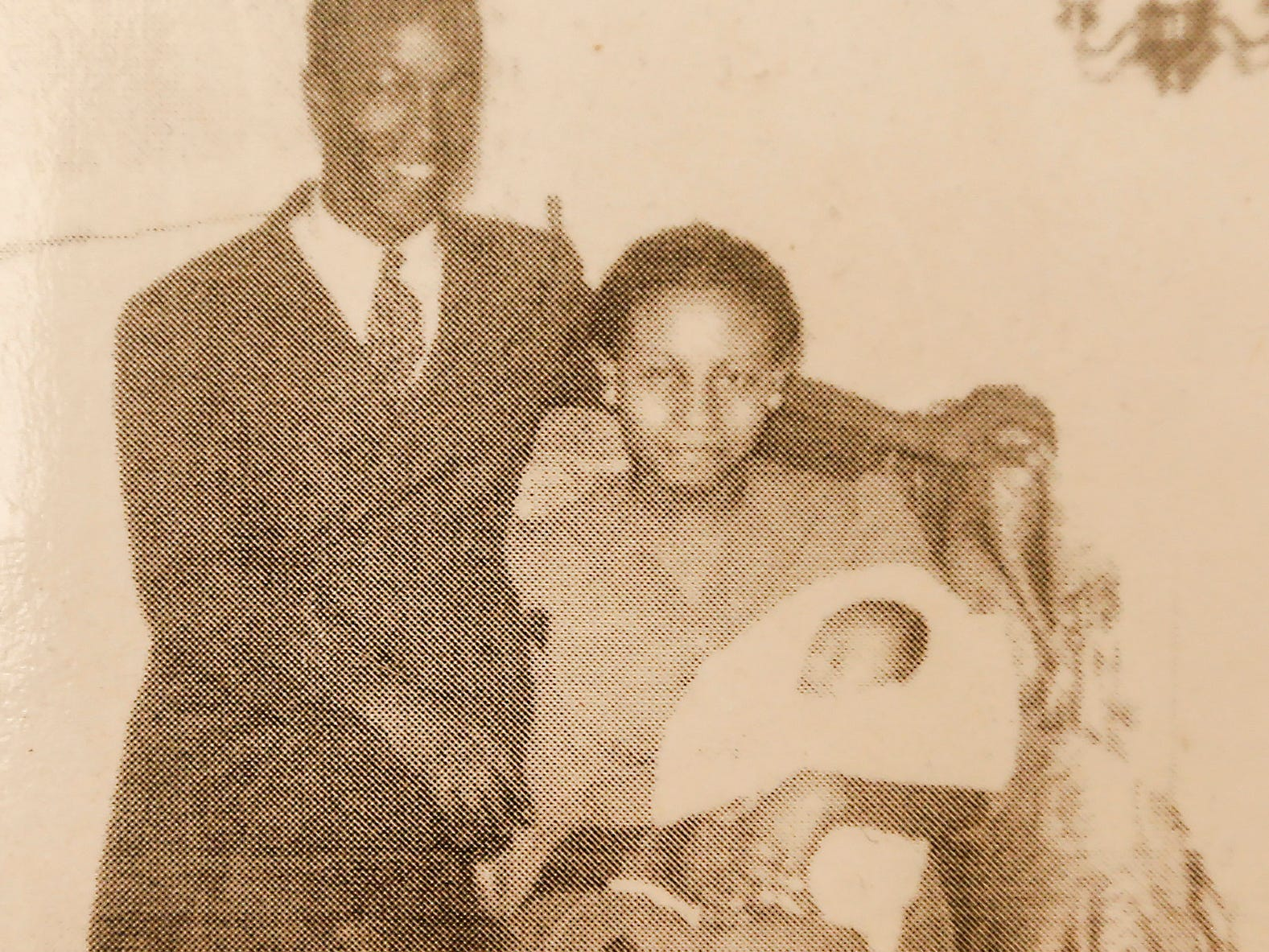 Denny Whayne pictured with his parents as an infant.
