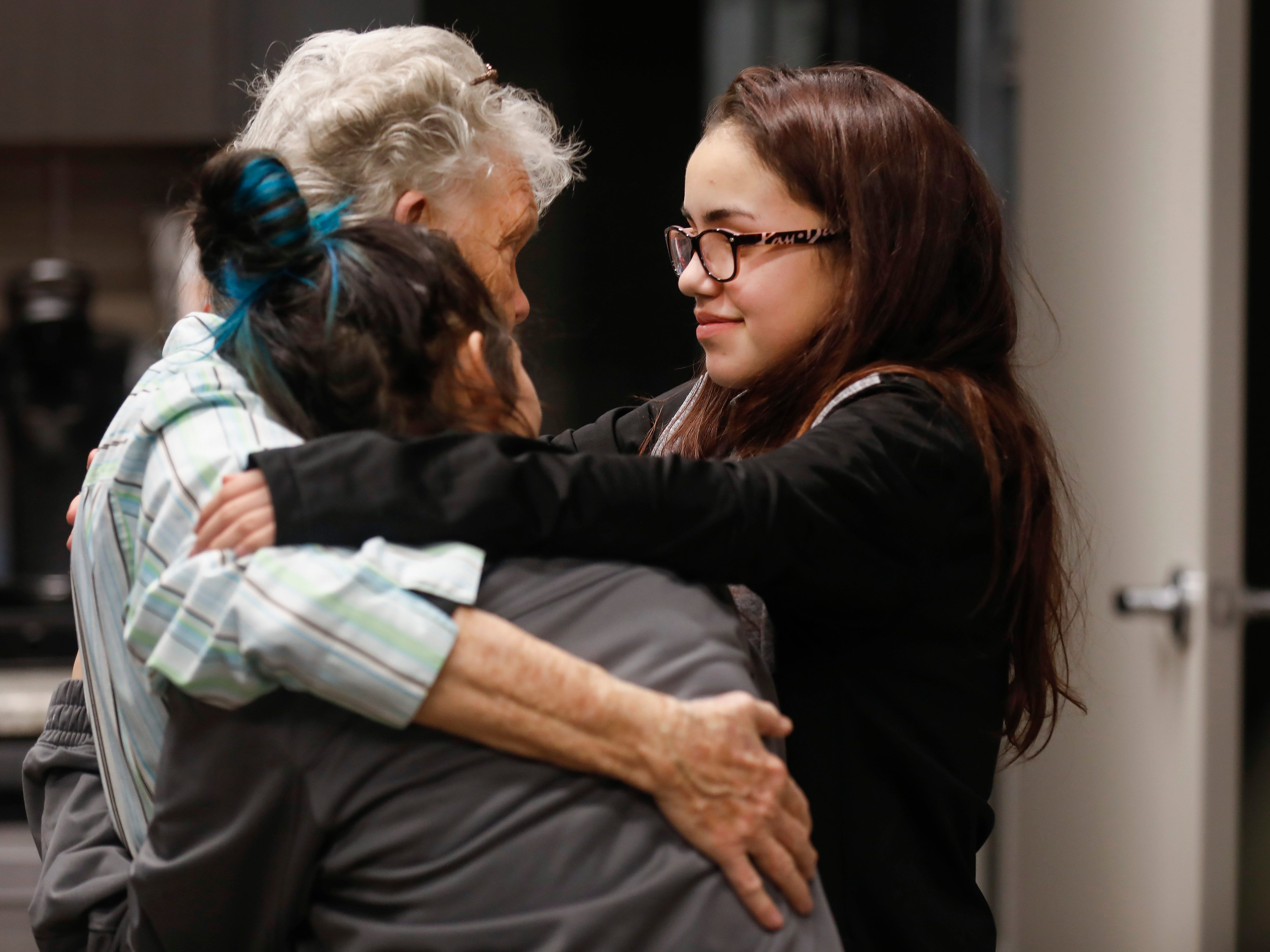 Pat Ayers hugs her great- granddaughters Abigail Sahagun, right, and Emileigh Sahagun after employees of J.D. Byrider gave them gifts and forgave their car loan on Wednesday, Dec. 19, 2018. Ayers daughter and the Sahaguns' grandmother, Barbara Foster, was killed during a road rage incident on Nov. 20.