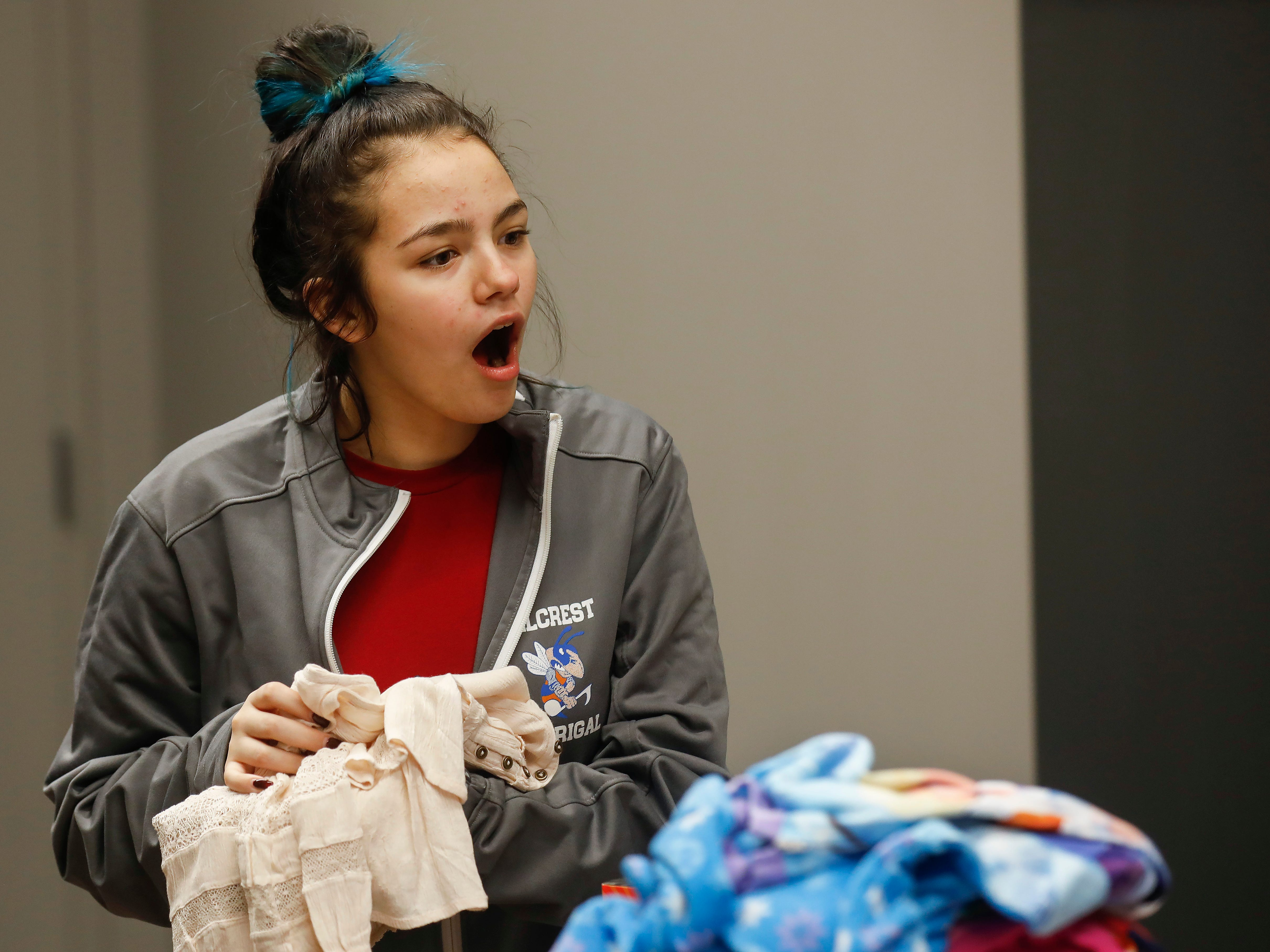 Emileigh Sahagun, center, reacts as she looks at gifts that were given to her and her sisters by employees of J.D. Byrider on Wednesday, Dec. 19, 2018. The Sahaguns' grandmother, Barbara Foster, was killed during a road rage incident on Nov. 20.