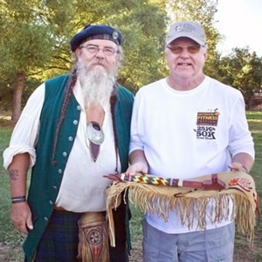 Martin Mac Donald, right, with a member of of the Pre-1840s Mountain Man Rendezvous at an Outdoor Days event.