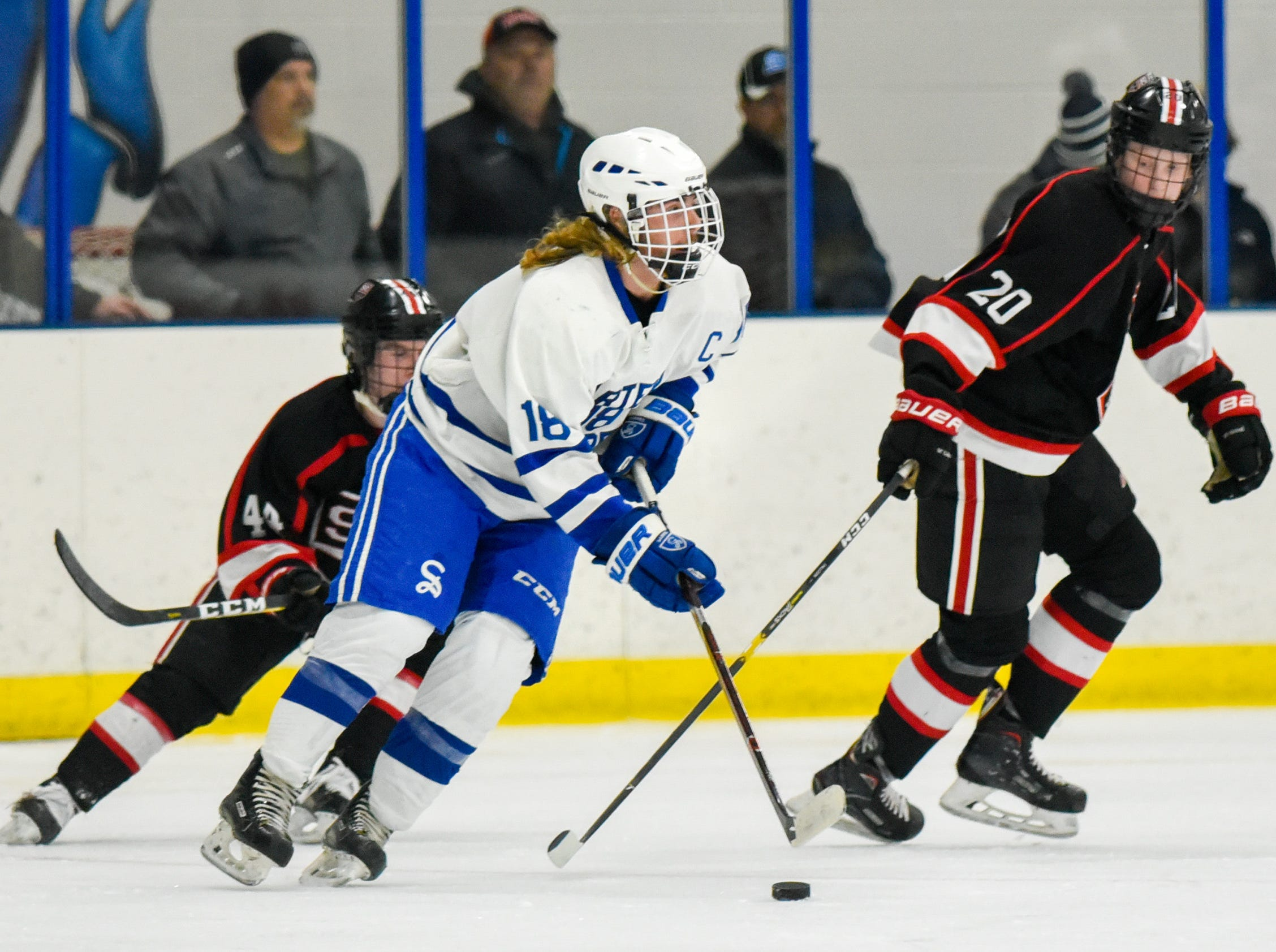 Sartell's Jack Hennemann skates with the puck against St. Cloud during the second period Tuesday, Dec. 18, at the Bernick's Arena in Sartell. The Sabres beat St. Cloud, 3-1.