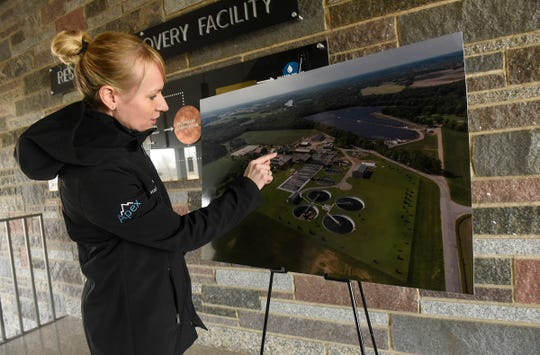 Assistant Public Utilities Director Tracy Hodel points to components in the biofuel recovery system Tuesday, Dec. 11, at the Wastewater Treatment Facility in St. Cloud.