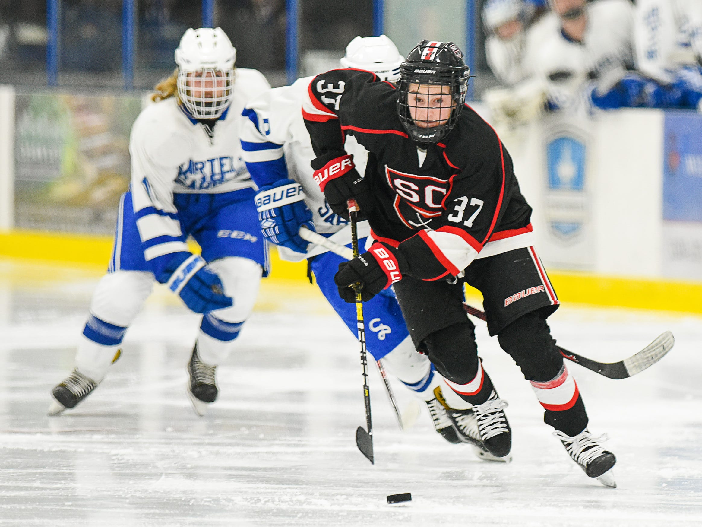 St. Cloud's Luke Johnson skates toward St. Cloud's goal during the second period Tuesday, Dec. 18, at the Bernick's Arena in Sartell.