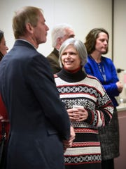 Tarryl Clark and Joe Perske gather in conversation during a retirement party for County Commissioner DeWayne Mareck Tuesday, Dec. 18, at the Stearns County Administration Center in St. Cloud.