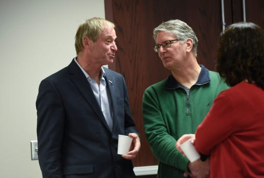 County commissioner Joe Perske talks with people during a retirement party for outgoing commissioner DeWayne Mareck Tuesday, Dec. 18, at the Stearns County Administration Center in St. Cloud.