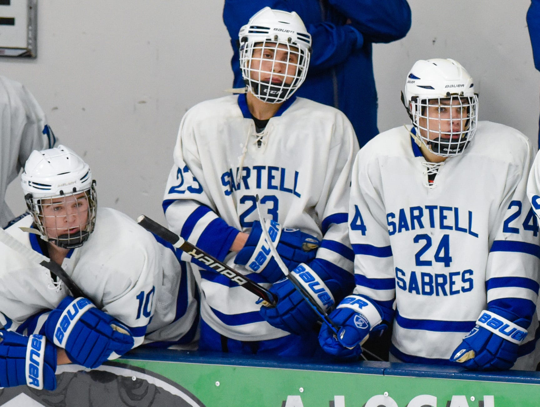 Sartell players watch from the bench during the first period Tuesday, Dec. 18, at the Bernick's Arena in Sartell.