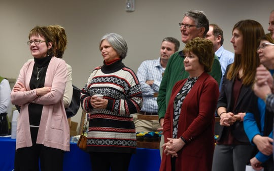 People listen as DeWayne Mareck speaks during his retirement party Tuesday, Dec. 18, at the Stearns County Administration Center in St. Cloud.