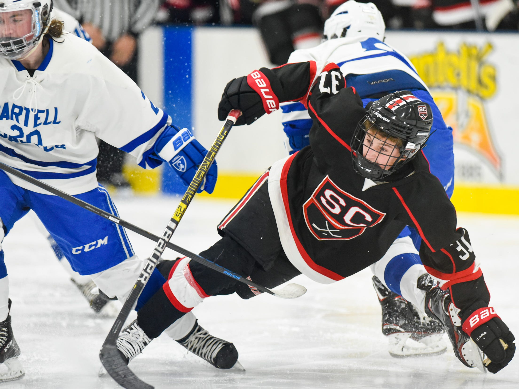 St. Cloud's Luke Johnson goes down chasing the puck against Sartell during the second period Tuesday, Dec. 18, at the Bernick's Arena in Sartell.