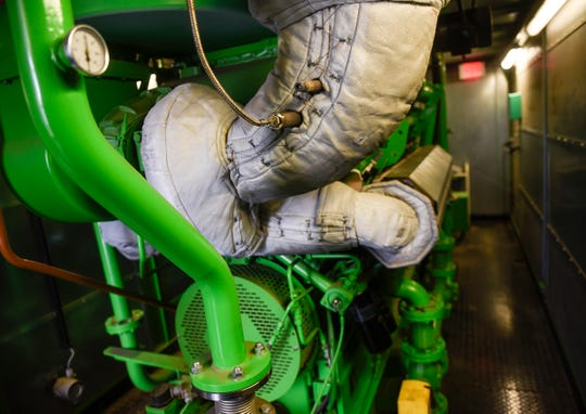 A large engine runs on biogas Tuesday, Dec. 11, at the Wastewater Treatment Facility in St. Cloud.