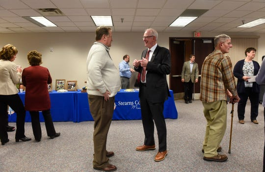 Outgoing commissioner DeWayne Mareck greets friends and family members during his retirement party Tuesday, Dec. 18, at the Stearns County Administration Center in St. Cloud.