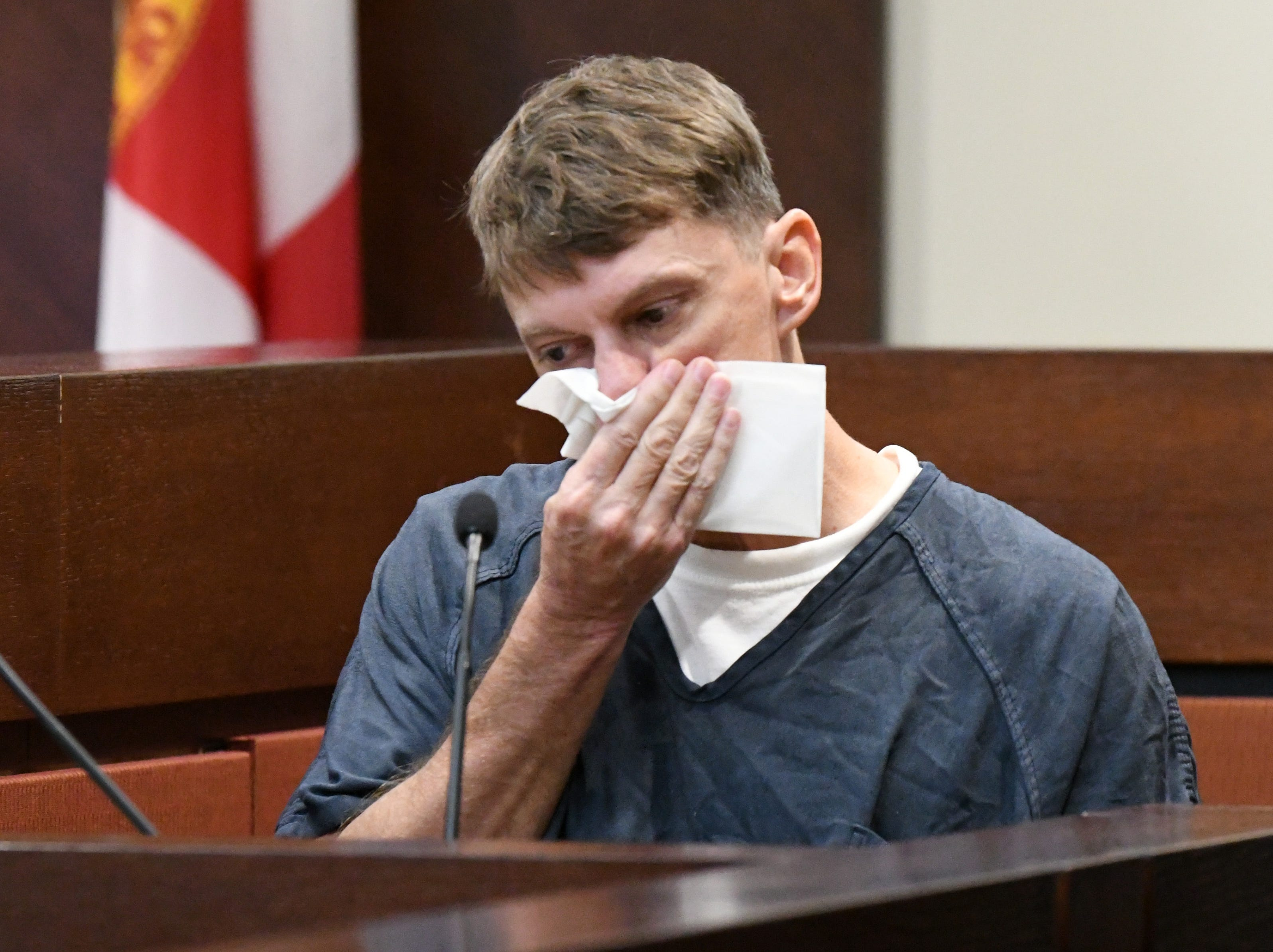Brian Winchester, the man who confessed to pushing his best friend overboard a boat, then shooting and killing Mike Williams, wipes away tears as he speaks about what occurred on Dec. 16, 2018. He was called by the prosecution team to be a witness in the trial against Denise Williams, Mike Williams former wife, Wednesday, Dec. 12, 2018.