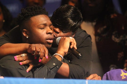 Godby senior Treon Patrick gets kissed by his mother Liwonda Patrick while signing a scholarship offer to play football at Alcorn State. Patrick comes from a single-parent household in Monticello where daily struggles were hard and college was no guarantee.