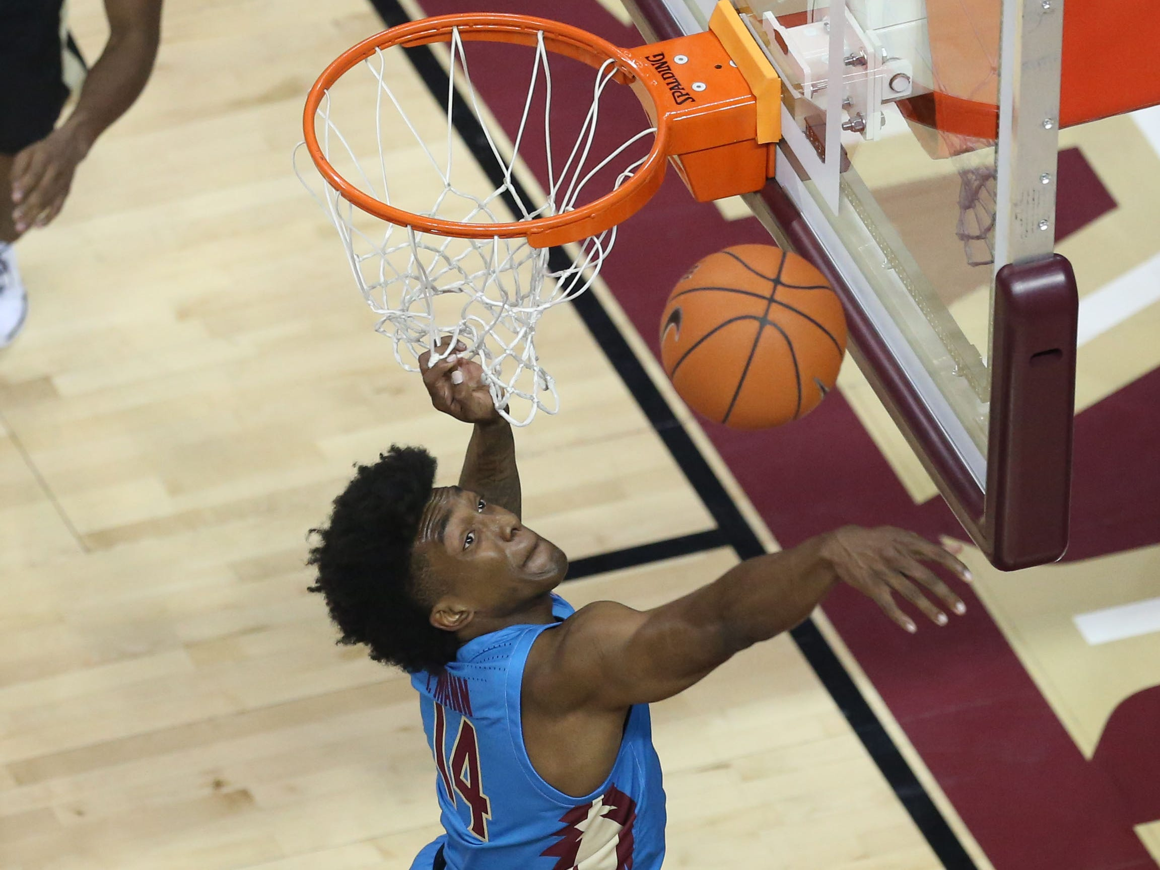 Florida State Seminoles guard Terance Mann (14) blocks a shot attempted by  Purdue Boilermaker as the Florida State Seminoles host the Purdue Boilermakers at the Tucker Civic Center, Wednesday, Nov. 28, 2018. The Seminoles beat the Boilermakers 73 - 72 with a last second shot.