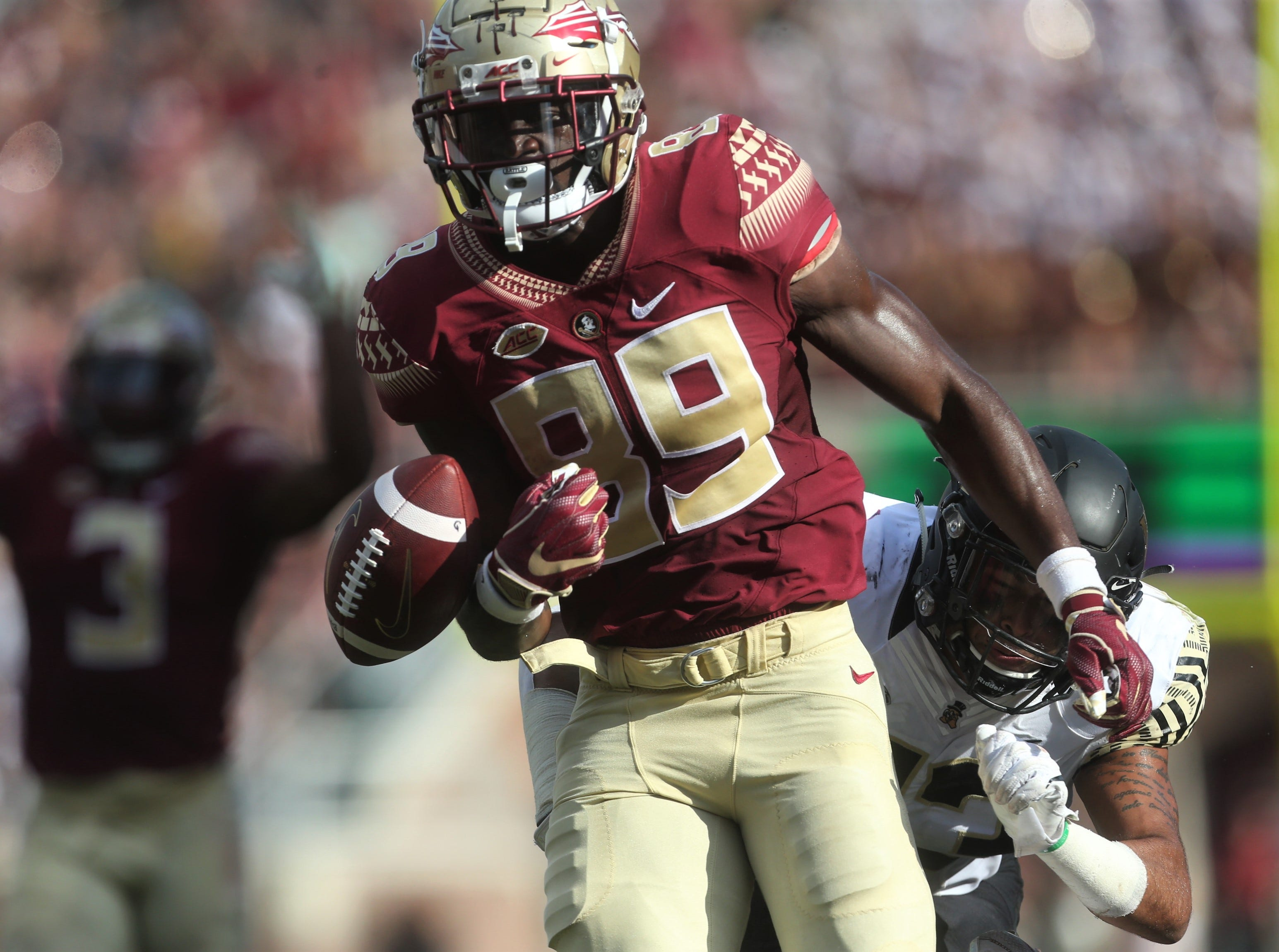 Florida State receiver Keith Gavin busts a long catch-and-run, but a Wake Forest defender comes from behind and creates a fumble just short of being a touchdown during a game at Doak Campbell Stadium on Oct. 10, 2018.
