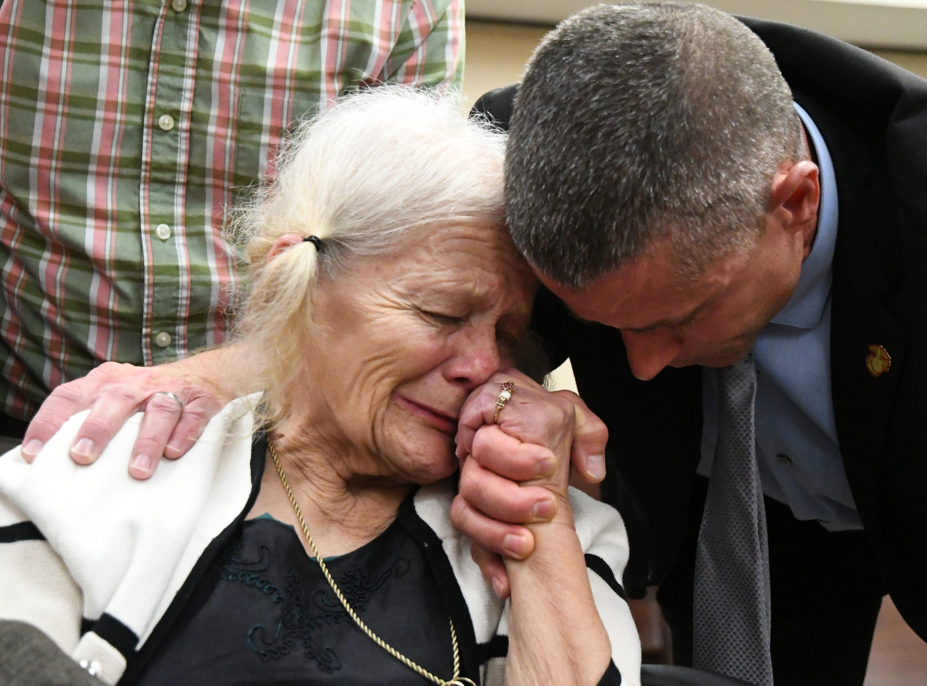 Cheryl Williams, left, mother of Mike Williams, the man who was shot and killed by his best friend Brian Winchester, 18 years ago, along side family friend Josey Visnovske, cry tears of joy for a the guilty verdicts in the trial against Denise Williams, Mike's former wife, Friday, Dec. 14, 2018. Denise and Winchester had a three year affair, during which the two conspired to kill Mike. Winchester pushed Williams overboard a boat, shot and killed him on Dec. 16, 2000.