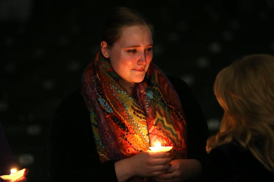 Kathleen Gredler, 25, a former Hot Yoga Tallahassee teacher, attends a vigil at the Hope, Healing, Harmony community event in honor of Maura Binkley and Nancy Van Vessem, the two women who were killed during the shooting at Hot Yoga Tallahassee,  The vigil was held at Cascades Park, Sunday, Nov. 11, 2018.