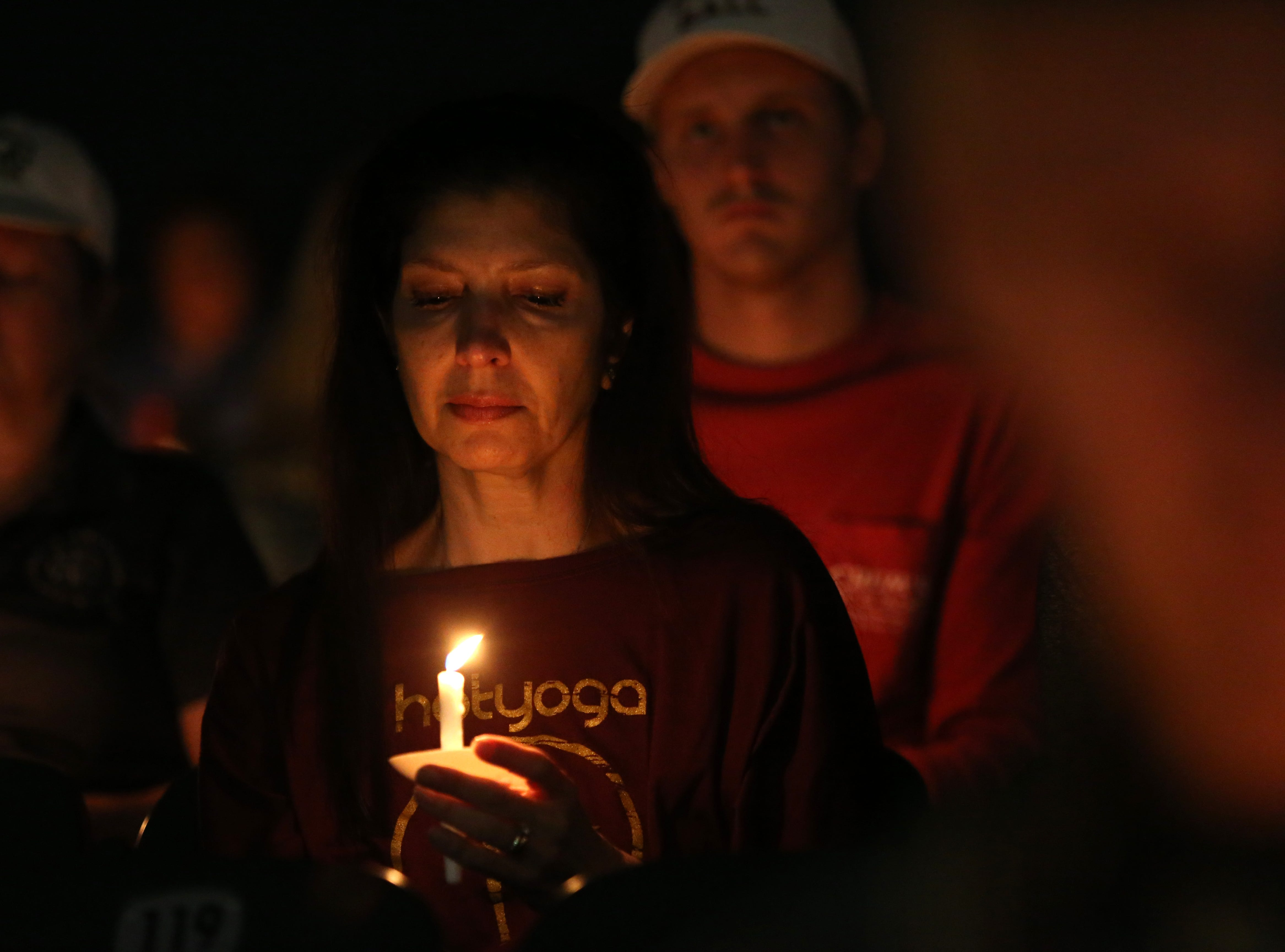 Hundreds gather for a vigil at the Hope, Healing, Harmony community event in honor of  Maura Binkley and Nancy Van Vessem, the two women who were killed during the shooting at Hot Yoga Tallahassee, Cascades Park, Sunday, Nov. 11, 2018.