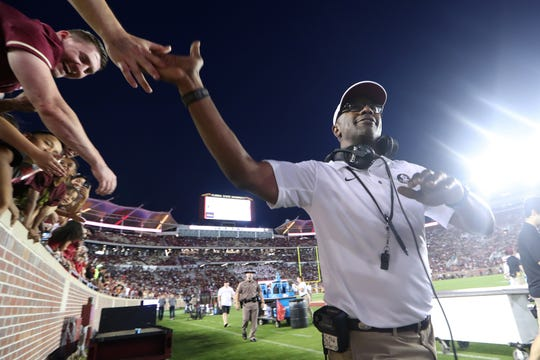 FSU Head Coach Willie Taggart high-fives fans during the Seminoles' Garnet and Gold Spring Game at Doak Campbell Stadium on Saturday, April 14, 2018.