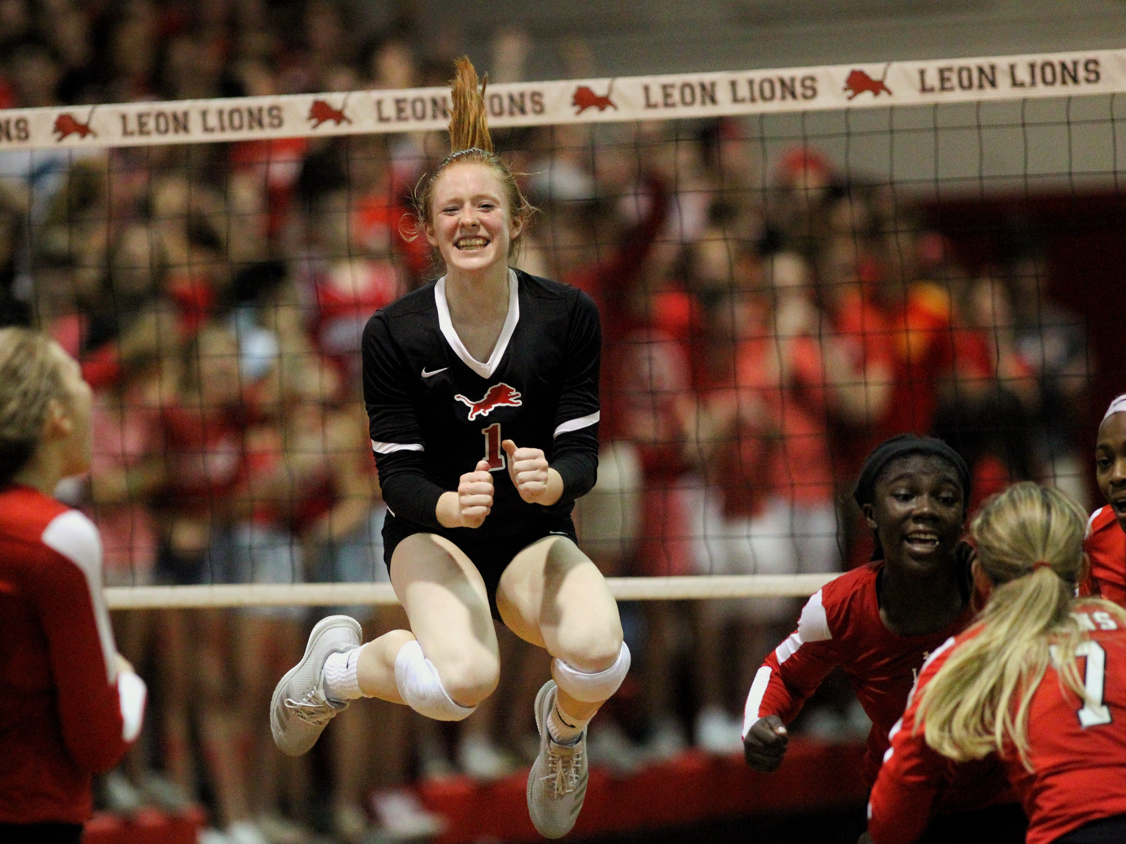 Leon High senior libero Kate Powell jumps for joy after the Lions' volleyball team secured a 3-0 win over district rival Chiles High during a regular-season game on Thursday, Sept. 6, 2018. Leon went on to enjoy a 27-4 season and a fourth-straight appearance in the Class 8A state semifinals.