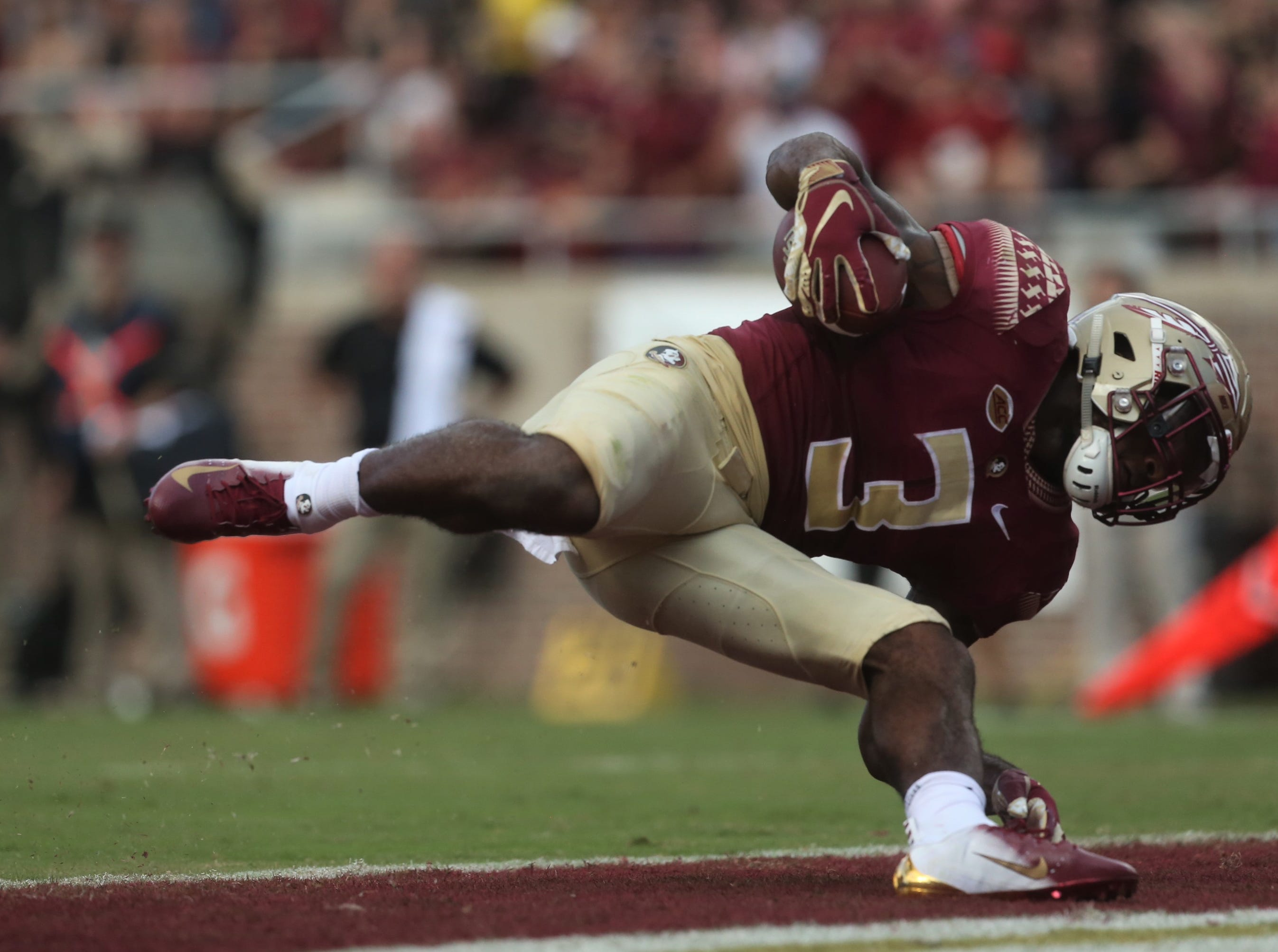 Florida State running back Cam Akers tries to keep his balance while falling into the end zone for a touchdown during a game against Wake Forest at Doak Campbell Stadium on Oct. 20, 2018.