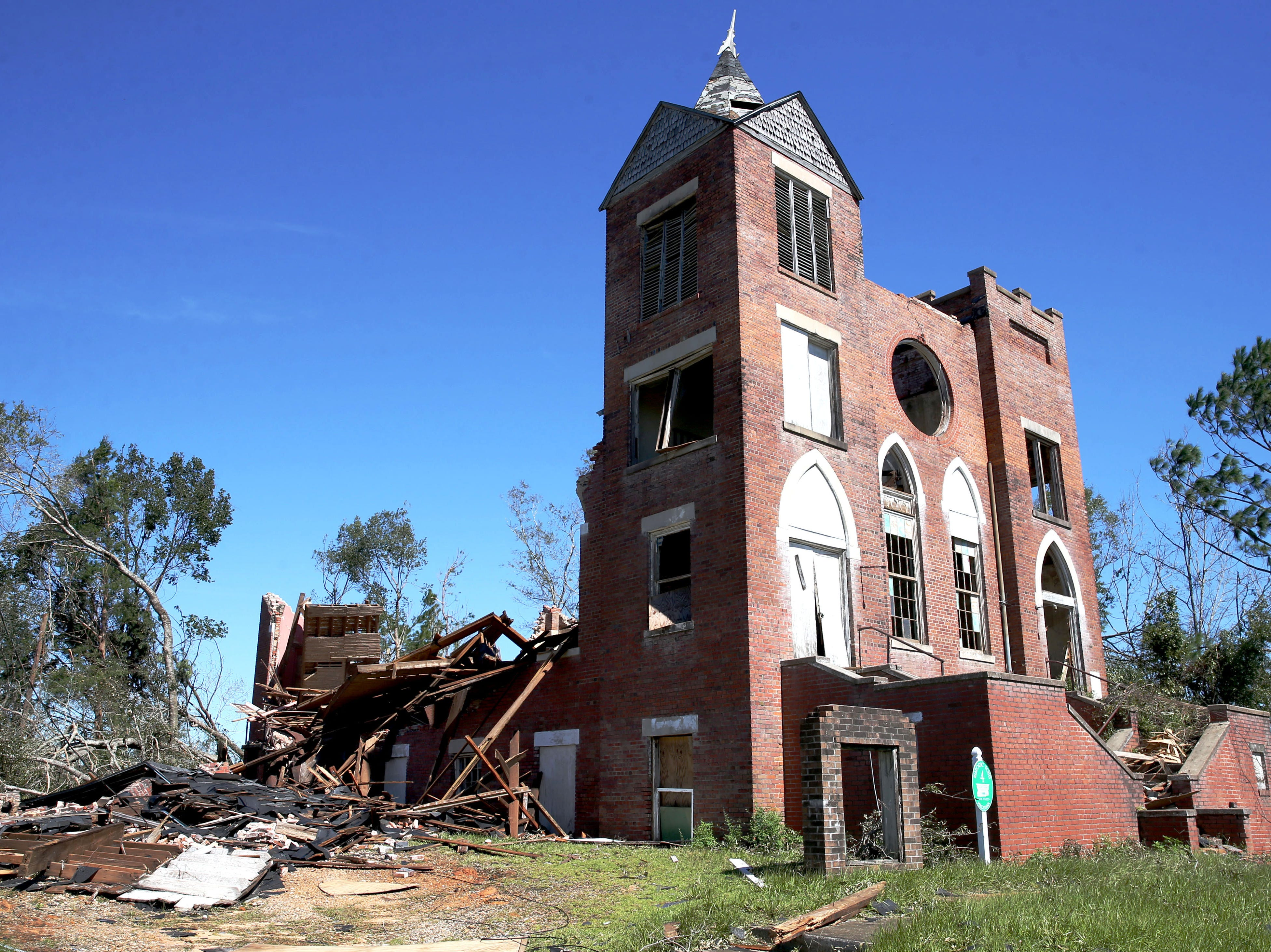 St. Luke's Baptist Church in Marianna, Fla. is left with shattered stained glass windows, missing doors and a pile of bricks after Hurricane Michael ripped through the panhandle on Wednesday, Oct. 10, 2018. The church was a stop on the historic tour through Marianna, that is before it had one wall left standing, Friday, Oct. 12, 2018.