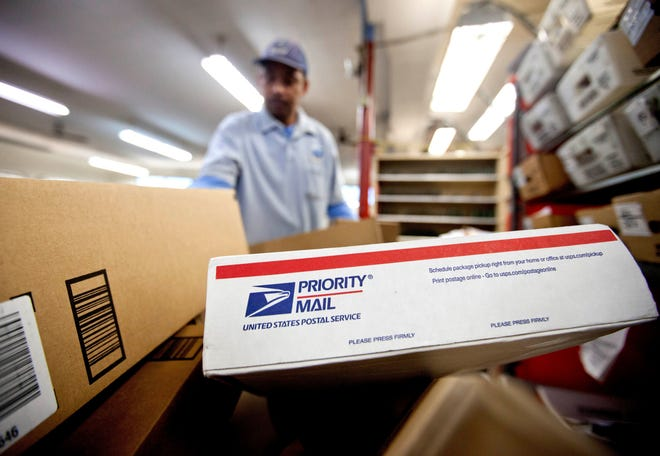 Packages pile up for sorting at a post office in Atlanta.   David Goldman/AP Packages waiting to be sorted in a Post Office in Atlanta.